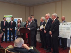 Rep. Goodlatte speaks at press conference, flanked by supporters, including NCC President Mike Brown (far right)